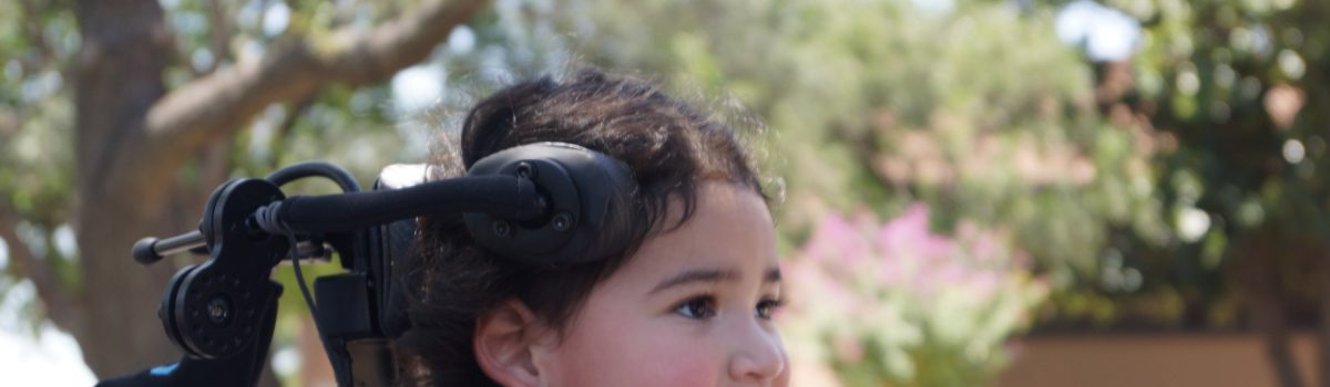 Wireless Hand-Mounted Communications Device and Wheelchair Switch for a Child